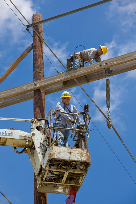 Xcel Energy workers on working on power lines